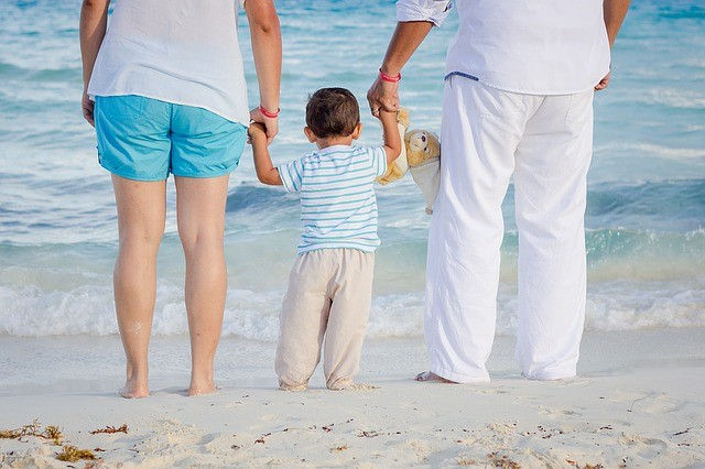 Survival guide for ivf (img): family with baby on beach