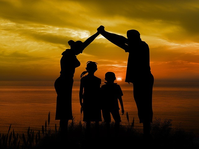 Adoption vs surrogacy img: family enjoying sunset