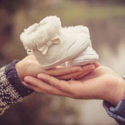 History of Surrogacy: baby shoes