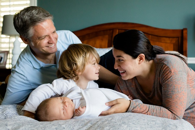 Pic. Happy family with children for Surrogacy is a chance to give birth to a baby without the presence of either of parent