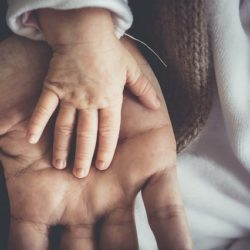 Baby's hand in fathers hand