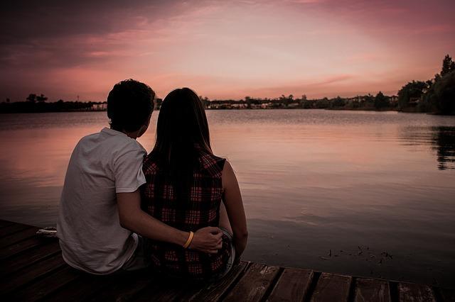couple thinking sunset